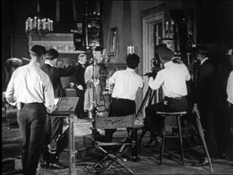 B/W 1922 REAR VIEW director, camera crew + musician filming love scene / documentary