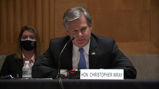 director christopher wray continues an answer for wisconsin senator ron johnson about the crossfire hurricane investigation that every individual... - an answer film title stock videos & royalty-free footage