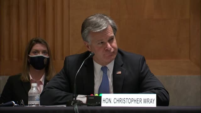 director christopher wray looks on as wisconsin senator ron johnson asks if the crossfire hurricane investigation of 2016 should have proceeded after... - an answer film title stock videos & royalty-free footage