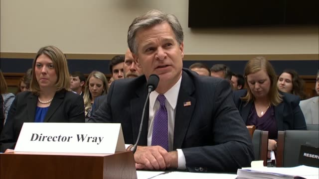 fbi director christopher wray tells the house judiciary committee at a hearing on 2016 investigations the bureau is committed to adhering to policies... - christopher a. wray stock videos & royalty-free footage