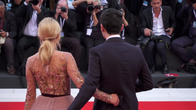 Director Damien Chazelle and actress Olivia Hamilton shine on the red carpet of 'First Man' during the 75th Venice Film Festival on August 29 2018 in...