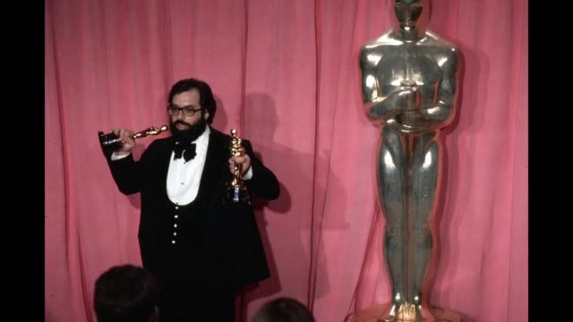 gif director francis ford coppola pose backstage with his oscar after winning 'best director' and 'best picture' award during the 47th academy awards... - dorothy chandler pavilion stock videos and b-roll footage
