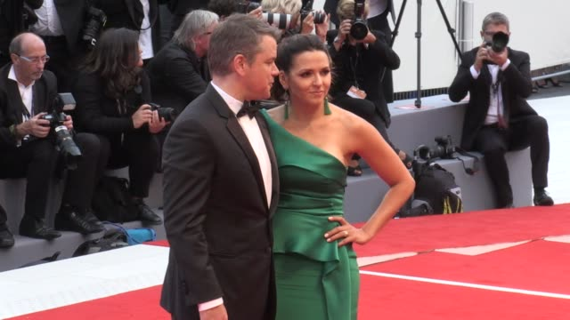 director george clooney matt damon and his wife luciana barroso julianne moore alexandre desplat and more on the red carpet for the premiere of... - luciana barroso video stock e b–roll