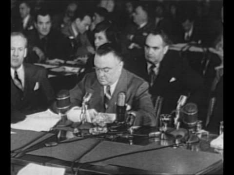 fbi director j edgar hoover swears in for testimony at the kefauver committee hearings / committee members at dais including sen estes kefauver... - court hearing stock videos & royalty-free footage