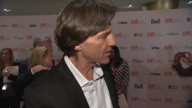 INTERVIEW Director James Marsh on screening the film at TIFF telling this story working with Eddie Felicity and what The Hawking's reaction was The...