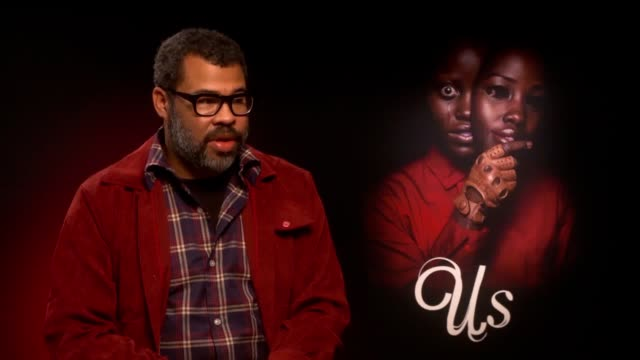 director jordan peele discusses his new psychological horror film us which stars lupita nyong'o winston duke elisabeth moss and tim heidecker it... - lupita nyong'o stock videos and b-roll footage
