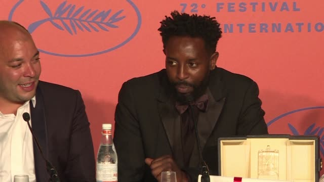 director ladj ly who shared the jury prize at the cannes film festival with the brazilian filmmakers behind bacurau and director celine sciamma who... - 72nd international cannes film festival stock videos and b-roll footage