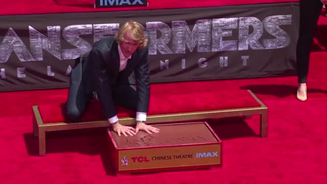 director michael bay known for his special effect films like armageddon bad boys or the transformers series places his hand and foot prints in cement... - special effect stock videos & royalty-free footage