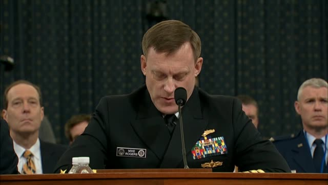 Director of the National Security Agency Admiral Michael Rogers reads remarks at a hearing inquiring into interference in the United States 2016...