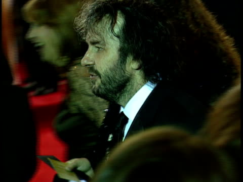 Director Producer Peter Jackson wife screenwriter Fran Walsh walking through crowded red carpet at Beverly Hilton hotel waving