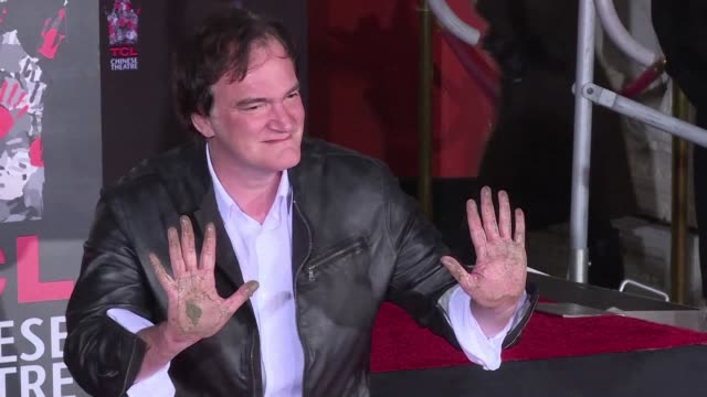 Director Quentin Tarantino left his hand and foot prints on the cement in front of Hollywoods historic Chinese theater where many film legends before...