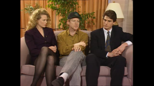 Director Ron Howard seated in between Nicole Kidman and Tom Cruise speaking about land rush scene during promotional interview with host Paul Holmes...