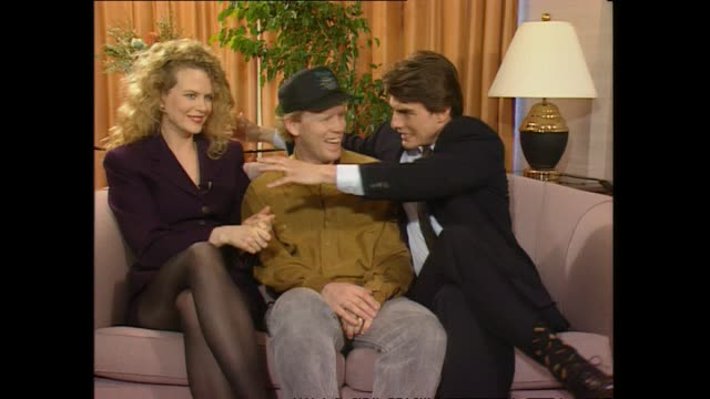Director Ron Howard seated in between Nicole Kidman and Tom Cruise speaking about working with the couple during promotional interview with host Paul...