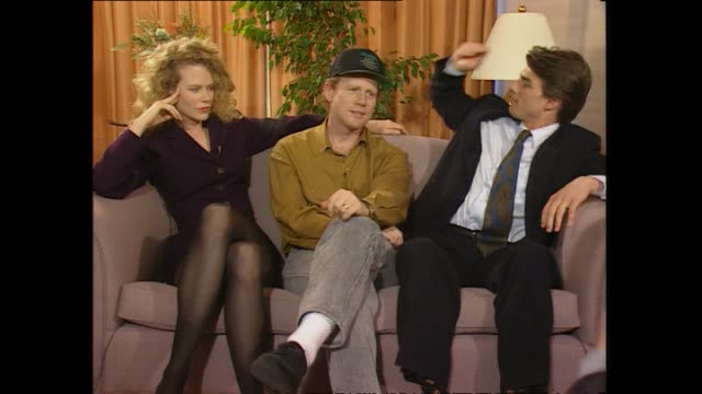 Director Ron Howard seated in between Nicole Kidman and Tom Cruise speaking about romance in his work during promotional interview with host Paul...