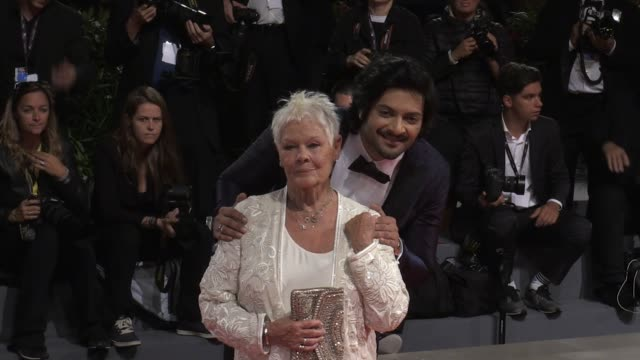 director stephen frears, judi dench, eddie izzard, ali fazal and more on the red carpet for the premiere of victoria and abdul at the venice film... - ジュディ・デンチ点の映像素材/bロール