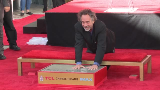 director tim burton is joined by actress winona ryder as he puts his handprints and footprints in cement at the iconic chinese theatre in hollywood - winona ryder stock videos & royalty-free footage