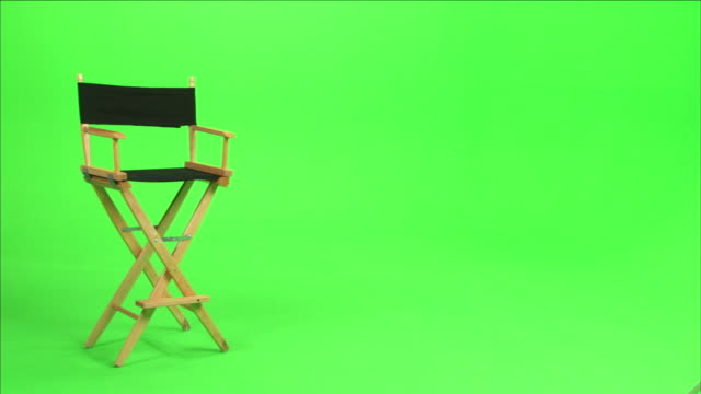 a director's chair sits in front of a green screen. - chair stock videos & royalty-free footage