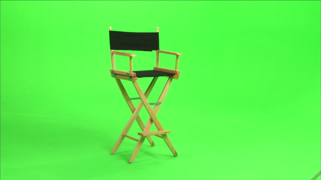 a director's chair sits in front of a green screen. - sessel stock-videos und b-roll-filmmaterial
