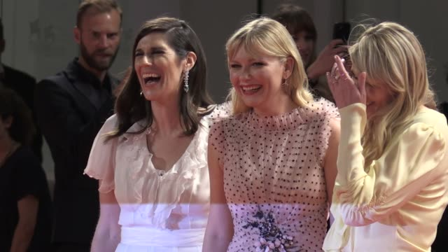 directors kate and laura mulleavy, pilou asbaek, kirsten dunst and more on the red carpet for the premiere of woodshock at the venice film festival... - 第74回ベネチア国際映画祭点の映像素材/bロール