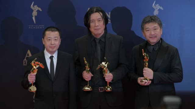 directors lee changdong and koreeda hirokazu present their awards to the press with scriptwriter jia zhangke at the winner's press conference of the... - scriptwriter stock videos and b-roll footage