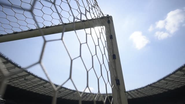directors of the mineirao stadium in belo horizonte announce they will cut up and sell to charity one of the goal nets used in brazil's humiliating... - horizonte stock videos & royalty-free footage