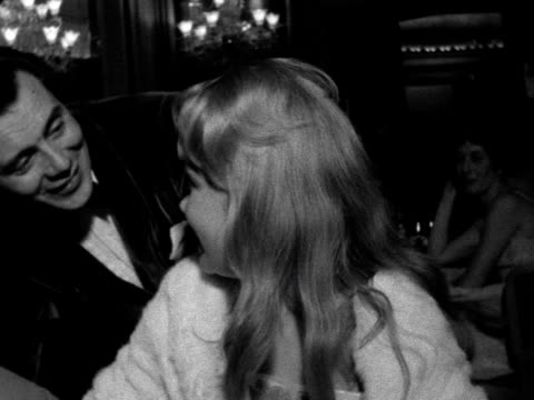 dirk bogarde laughs and chats with hayley mills at the british film academy awards. 1961. - actress stock videos & royalty-free footage