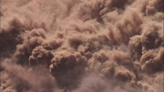 Dirt billows after an explosion. Available in HD.
