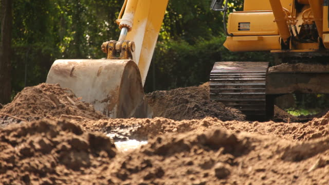 dirt excavation - bulldozer stock videos and b-roll footage