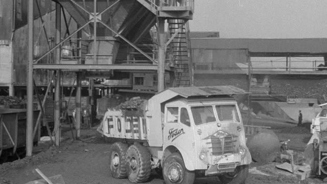 1954 montage dirt pouring into back of foden dump truck at loading station and then driving muddy, rutted route down hairpin hill to disposal area / arkwright, england, united kingdom - 1954 stock videos & royalty-free footage