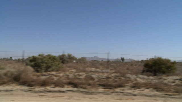 ws pov dirt road in desert / palmdale, california, usa   - palmdale stock videos and b-roll footage