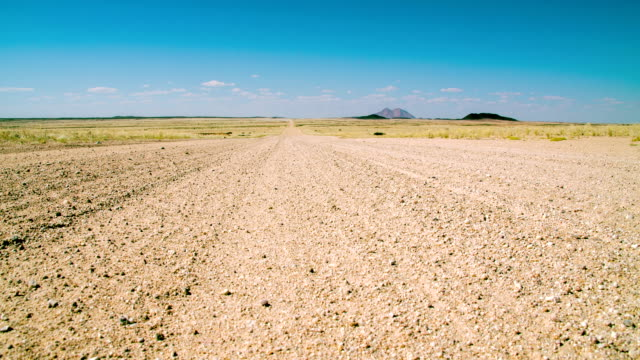 la ds dirt road in namibia - arid stock videos & royalty-free footage