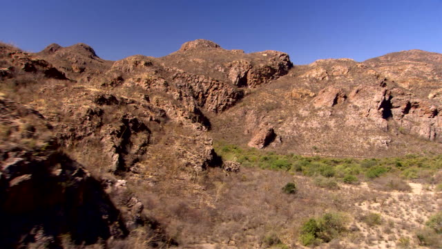 a dirt road runs through a rugged desert in sonora, mexico. available in hd. - cactus stock videos & royalty-free footage