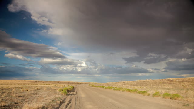ws t/l dirt road with stormy sky / flagstaff, arizona, usa - remote location video stock e b–roll
