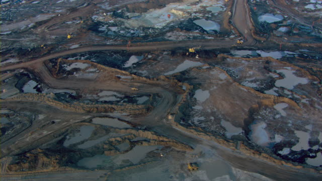dirt roads criss-cross the athabasca oil sands at fort mcmurray, alberta, canada. - alberta stock videos & royalty-free footage