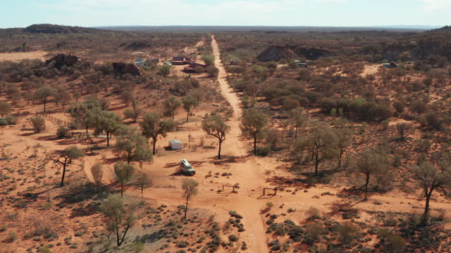 a dirt track to a homestead in the simpson desert - extreme terrain stock videos & royalty-free footage