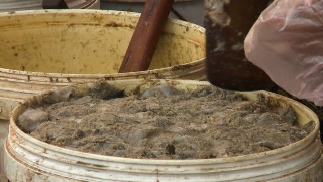 dirty buckets full of manure flattened by worker - imperfection stock videos & royalty-free footage