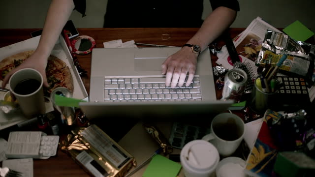 dirty, cluttered desk of someone working overnight  de  ed - desk stock videos & royalty-free footage