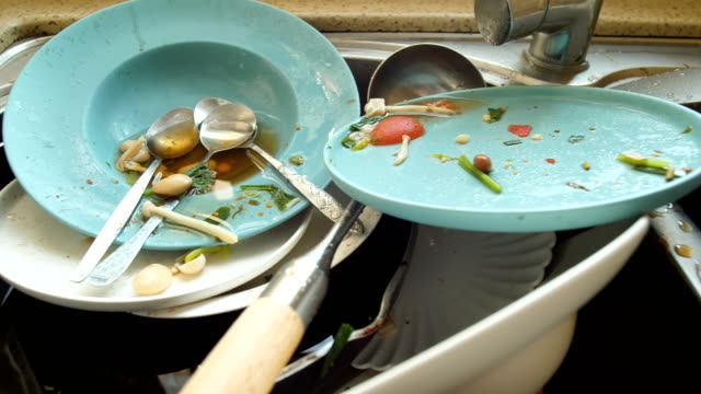 dirty dishes in kitchen - washing up stock videos & royalty-free footage