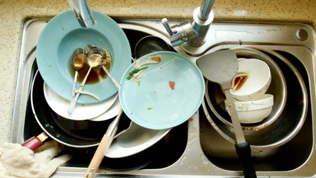 dirty dishes in the sink - washing up stock videos & royalty-free footage