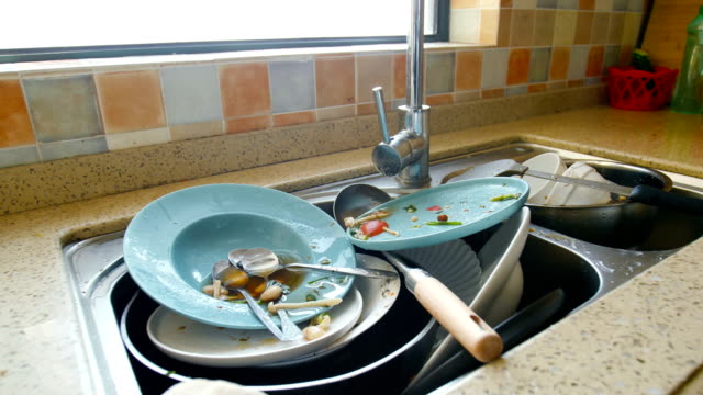 dirty dishes in the sink - messy stock videos & royalty-free footage