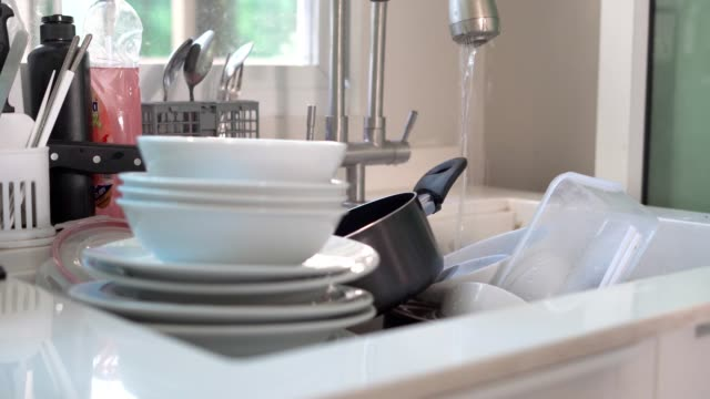 dirty dishes in the sink - cooking pan stock videos & royalty-free footage
