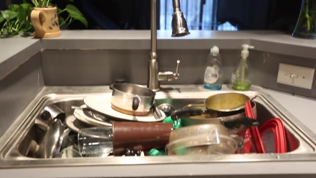 dirty dishes - washing up stock videos and b-roll footage