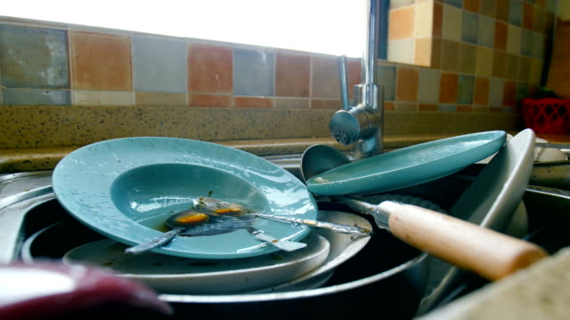 dirty dishes waiting wash - hygiene stock videos and b-roll footage