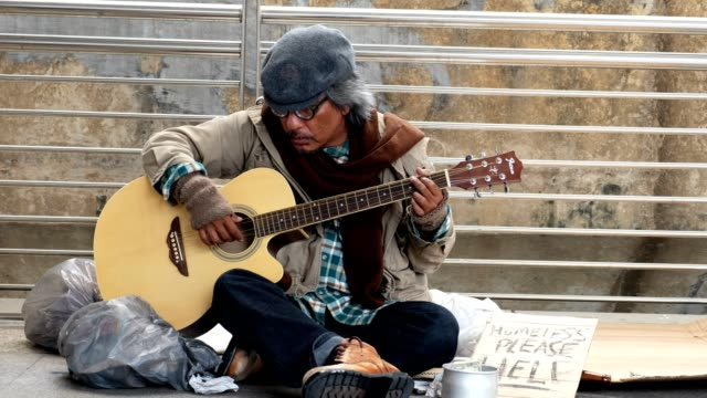 dirty homeless person sit with playing guitar - tramp stock videos & royalty-free footage