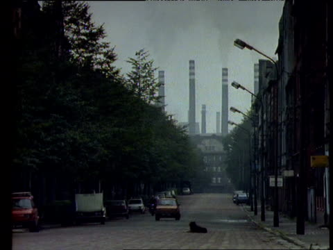 Dirty polluted street with smelter chimneys behind, Silesia, Poland