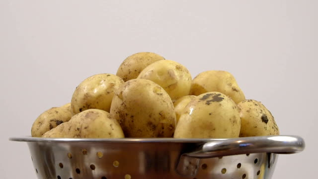 dirty potatoes in a colander - imperfection stock videos & royalty-free footage