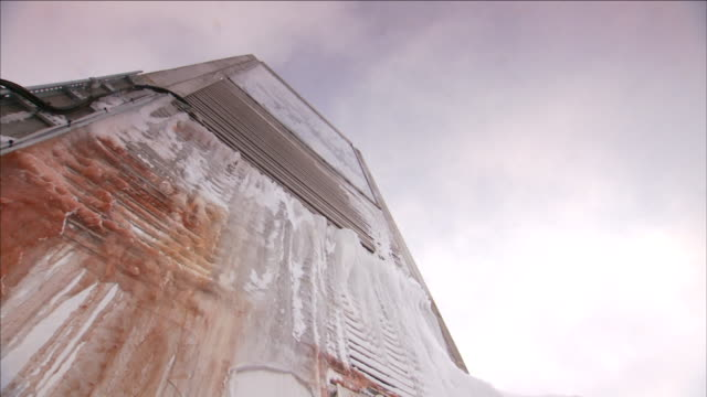 dirty snow covers the facade of a building. - imperfection stock videos & royalty-free footage