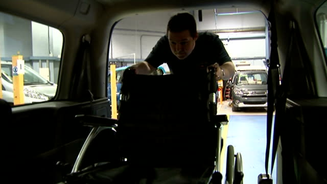 disability claimants lose car benefit due to re-assessments after welfare changes; mechanic adapting vehicle in motability workshop close shot... - baroness stock videos & royalty-free footage