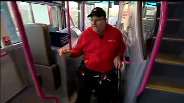 vídeos de stock e filmes b-roll de courts rule that buggies can take disabled spaces on buses england leeds ext doug paulley along pavement in his wheelchair bus driver lowering ramp... - baixar