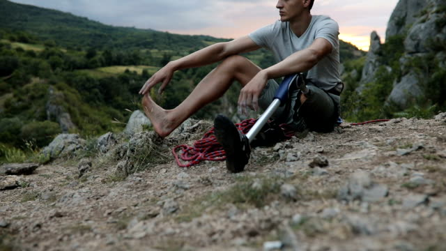 disability guy resting after climbing - prosthetic equipment stock videos & royalty-free footage